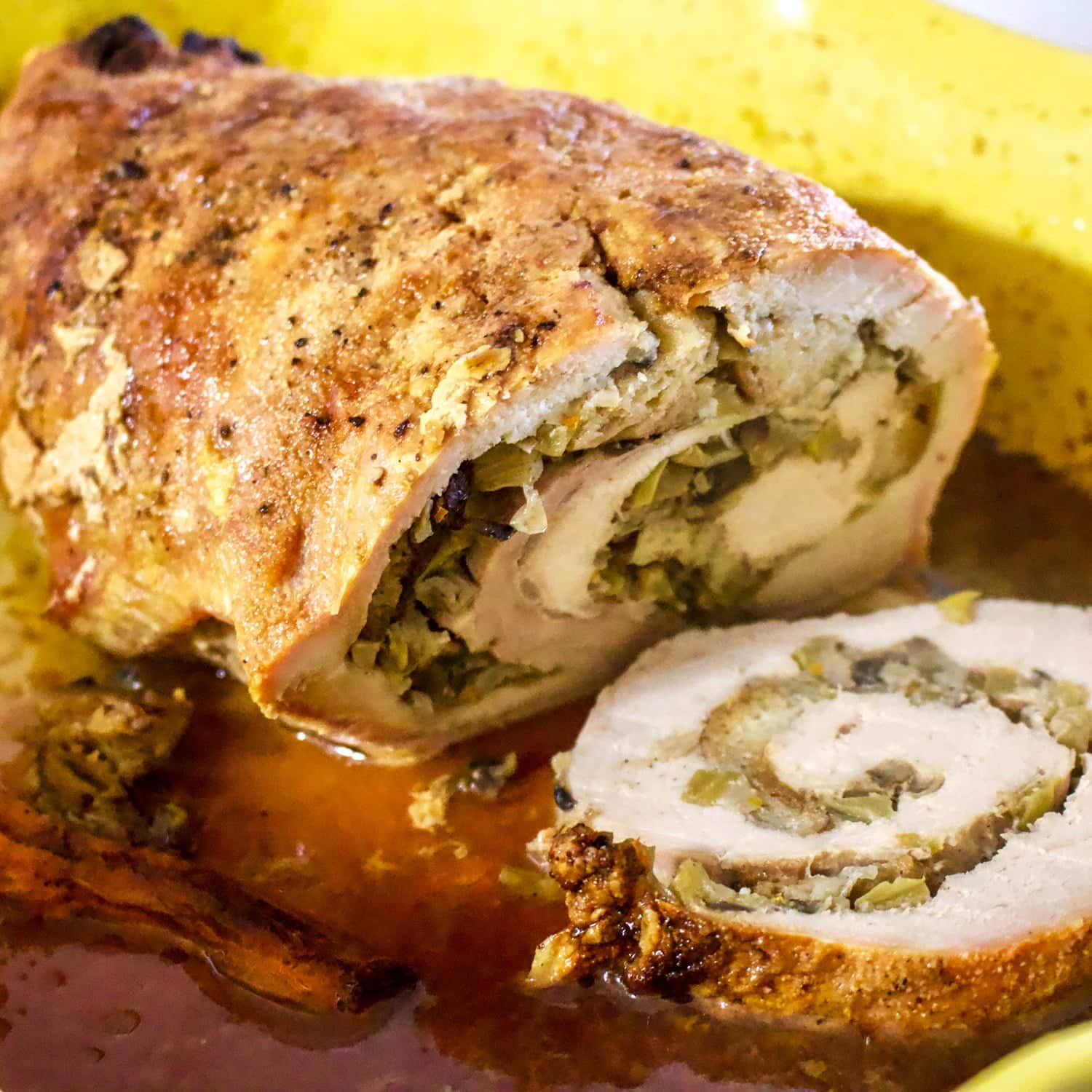 Apple and mushroom stuffed roasted pork tenderloin is a recipe that makes a great alternative for the usual ham around the holidays.