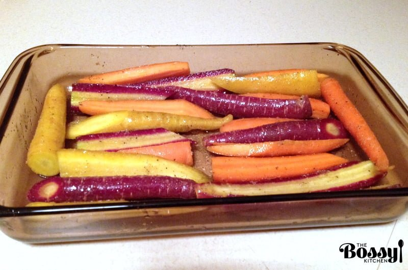 carrots seasoned and oiled ready to be roasted
