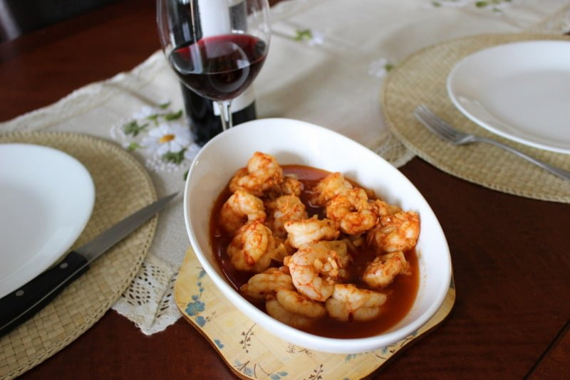 Sizzling Chili Shrimp-Spanish Recipe,  or Gambas al Pil Pil in a bowl on the table