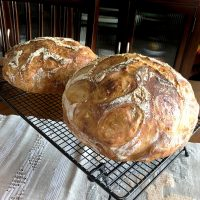 No knead bread- two round breads on a wire rack