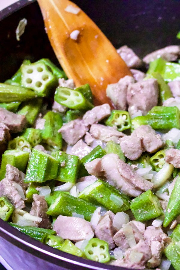 Okra with Chickpeas and Pork- onions, okra, bell pepper, garlic and pork cooking together