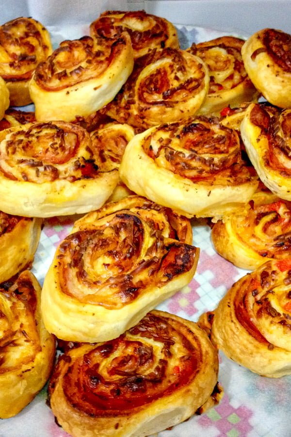 Sausage Pumpkin Pinwheels Appetizers is a great recipe for parties or potlucks around fall or winter holidays. Easy to make, this recipe uses just few ingredients, like puff pastry, sausages, pumpkin puree, cheese and green onions. Delicious and perfect! Enjoy!#pinwheels #appetizers