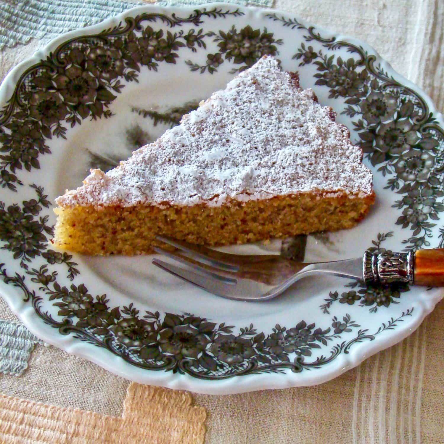 Spanish Almond Cake Recipe- Tarta de Santiago- A traditional Spanish cake that requires little effort to make, it is delicious and also gluten-free. If you love almonds, this recipe is for you. The recipe is suitable for holidays, dinners in the family or any other events when an easy dessert is required.