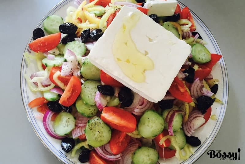tomato, pepper, cucumber salad with feta cheese and olives - overhead picture