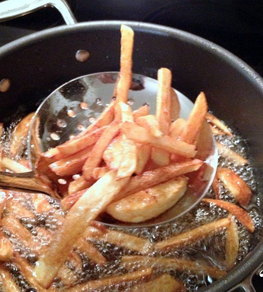 French Fries in oil cooking