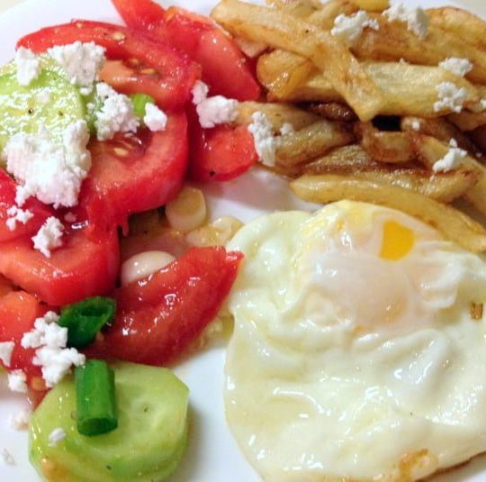 French Fries with tomato salad and fried egg