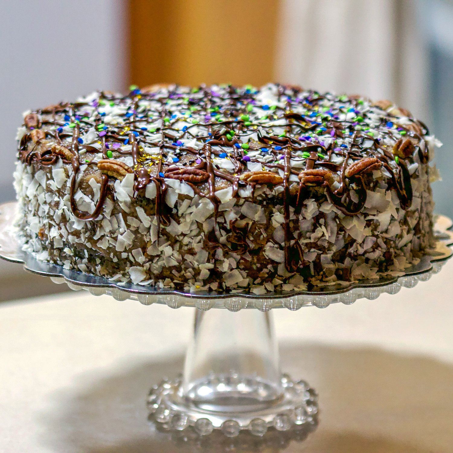 Best homemadeGerman Chocolate Cake that you will fall in love with. This is not your traditional German Chocolate cake. It is less sweet but full of flavors.