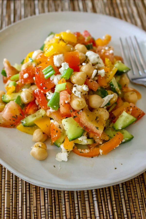 Easy Chopped Chickpea Salad With Feta And Mint- on a white plate