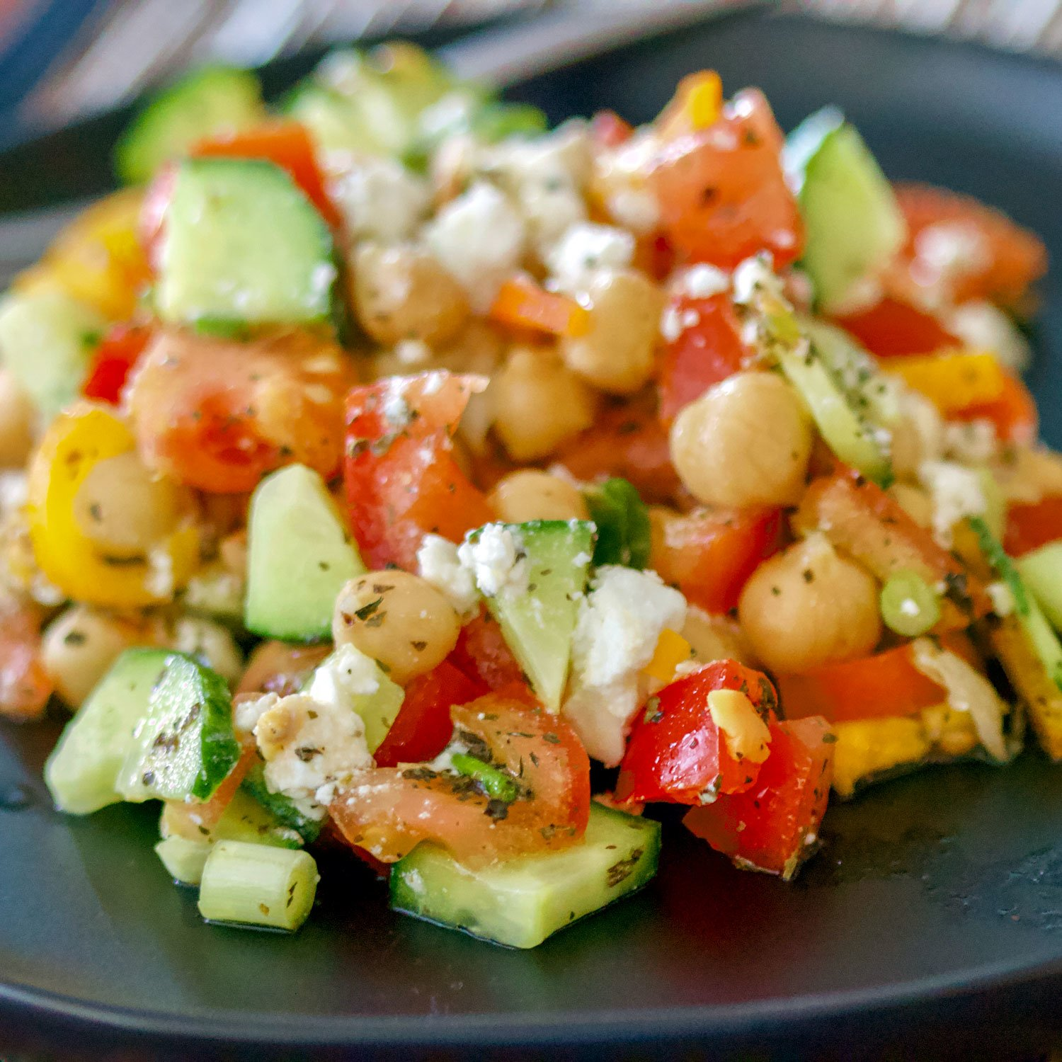 This Easy Chopped Chickpea Salad with Feta and Mint is a great recipe for any day of the year. Grab that can of chickpeas from your pantry and make the recipe in less than 10 minutes. Use fresh mint and basil in the summer or dried herbs in the winter. Healthy, easy and delicious!