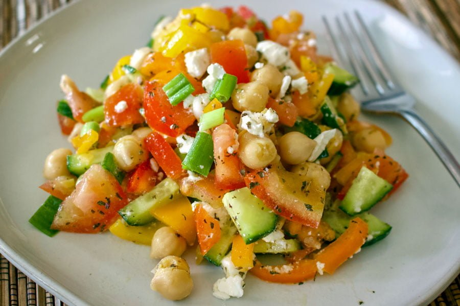 Easy Chopped Chickpea Salad With Feta And Mint- on a white plate, with fork