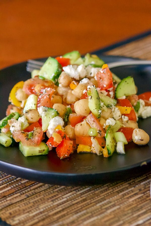 Easy Chopped Chickpea Salad With Feta And Mint on a black plate