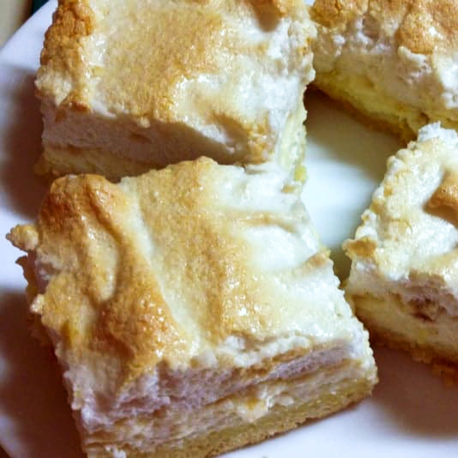 Meringue Farmer Cheese Cake is a delicious dessert that comes from Transylvania. It has three layers: crust, farmer cheese and meringue.