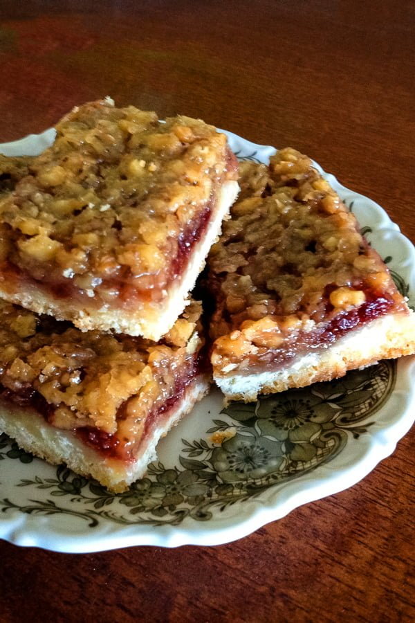 A delicious recipe of Saxon Walnut and Rose Hip Jam Bars from Transylvania. The rose hip is the star of the recipe but plum or lingonberry jam works too.