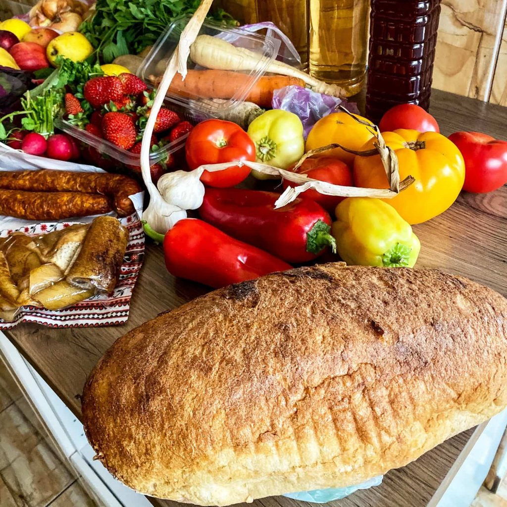 Vegetables at the Farmers' Market with bread- phot used for the Frequently Asked questions- Faq