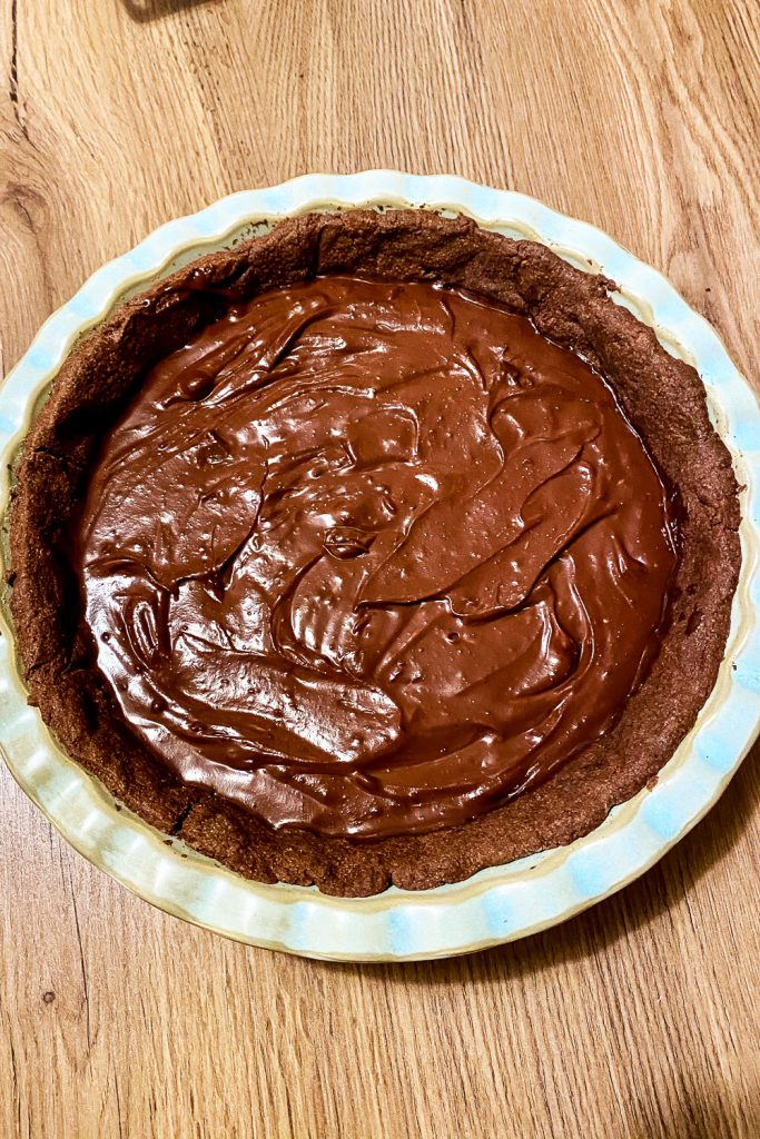 Baked chocolate tart crust with chocolate filling added