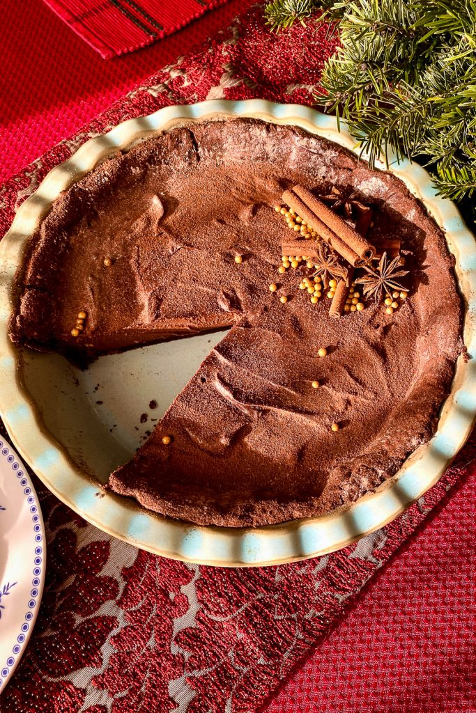 CHOCOLATE TART WITH STAR ANISE AND CINNAMON- on red tablecloth