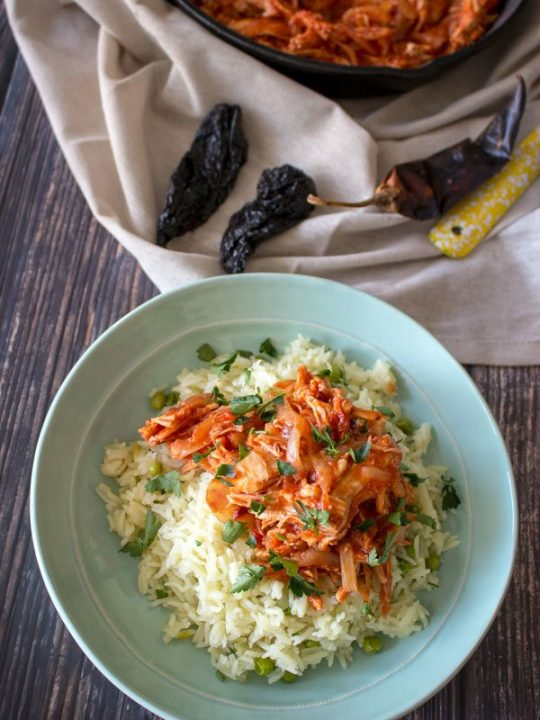 Easy Mexican rice served with chicken tinga