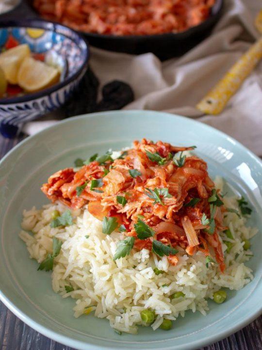 Mexican rice served with Tinga de pollo