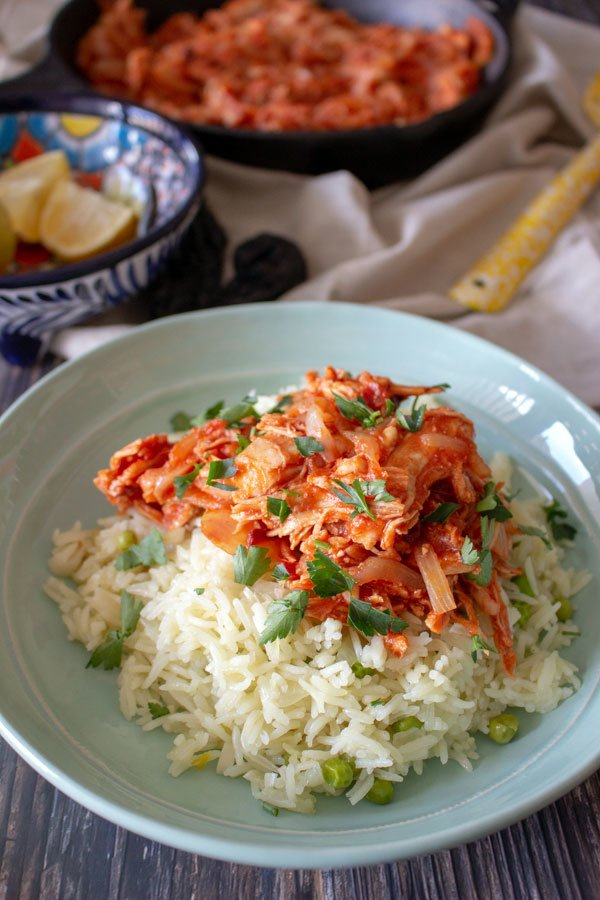 Mexican rice served with Tinga de pollo