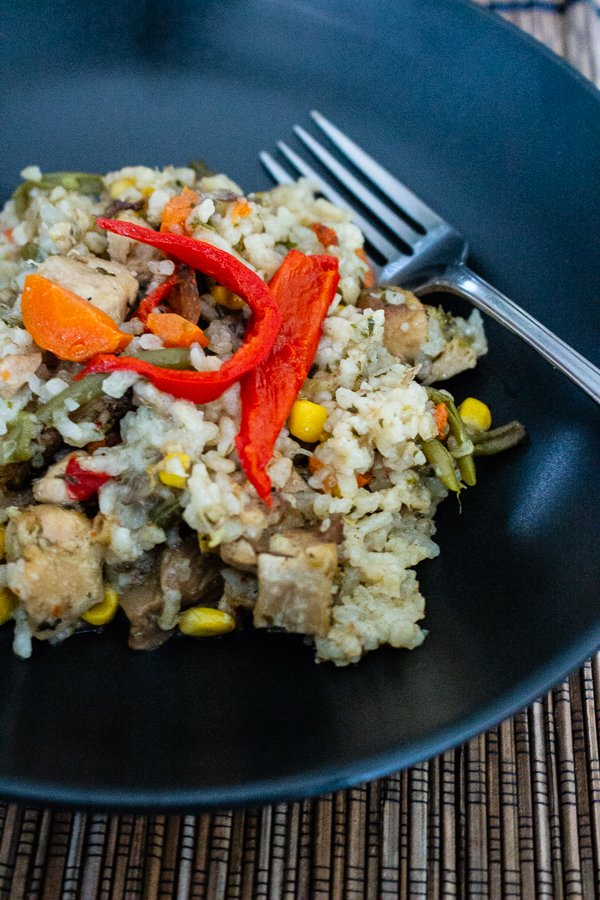 Rice pilaf with pork and vegetables is a versatile dish that can be made with your favorite vegetables. The rice pilaf in my version is either cooked on the stove or baked in the oven, which I like the best. The meat used in the pilaf is usually chicken, but pork or beef are accepted too.