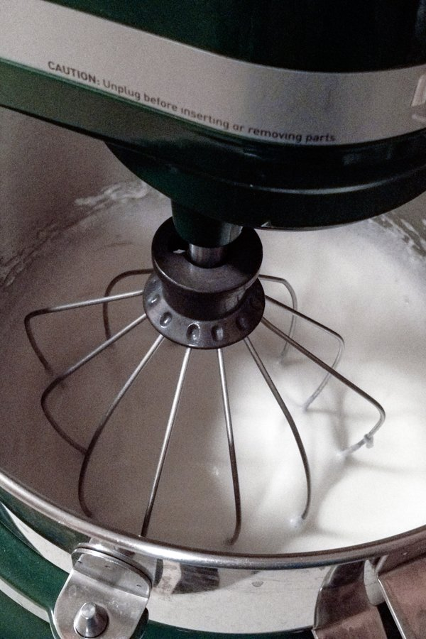 Egg whites in the mixer for Royal cake recipe