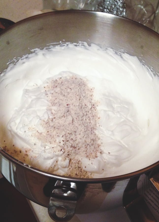 egg whites with flour in a bowl