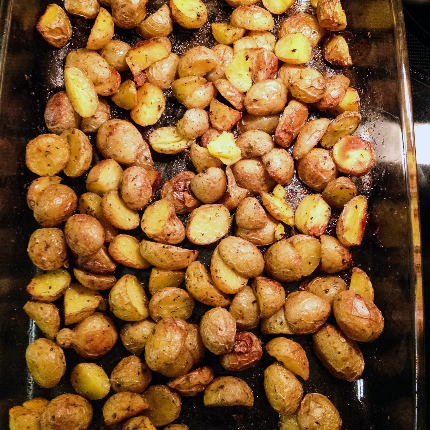 Roasted potatoes in a glass pan