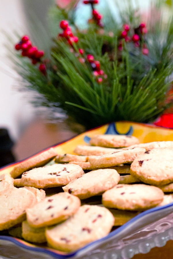 almond-cranberry shortbread cookies on a yellow platter