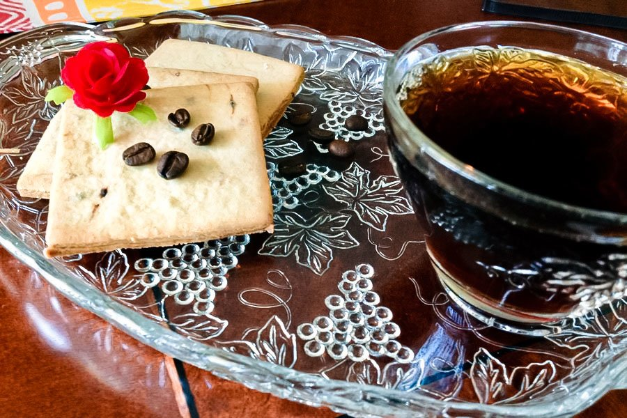 Coffee Flavored Sugar Cookies on a plate with a cup of coffee