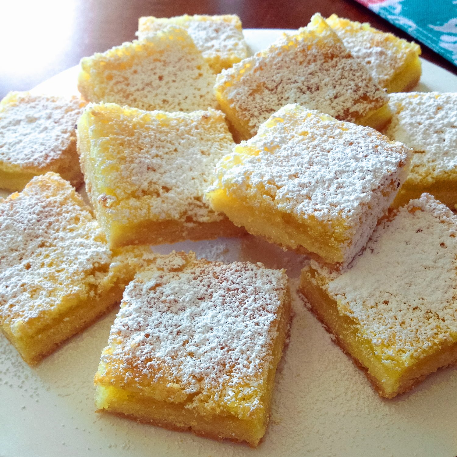 These Super Easy Lemon Bars have a serious lemon hint. Perfect with a cup of coffee or tea, this recipe is suitable for any ocassion.