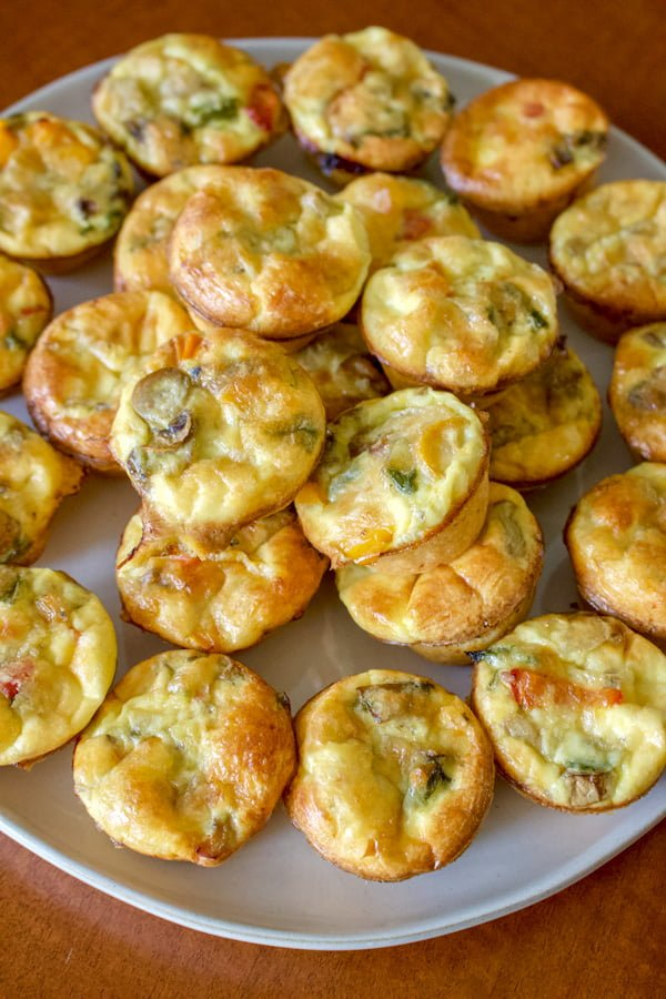 Easy Vegetarian Mini Quiche Recipe - multiple mini quiche on a big platter