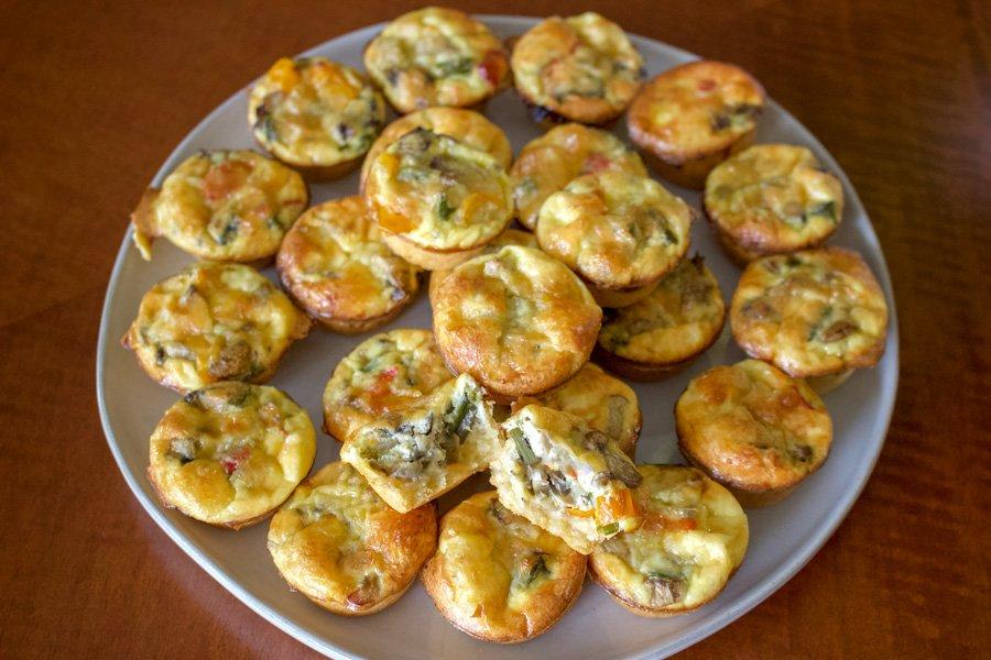 Easy Vegetarian Mini Quiche Recipe - multiple mini quiche on a white platter