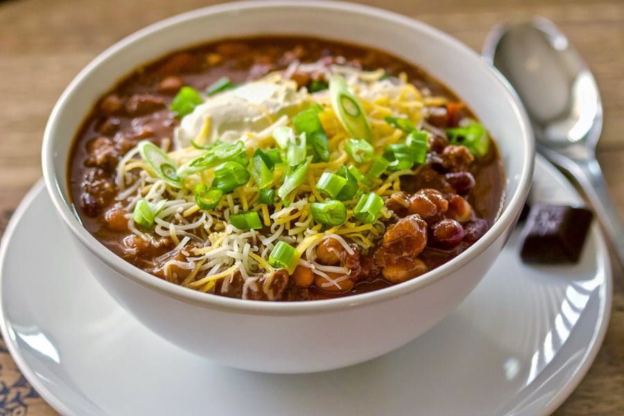 Never had chocolate chipotle chili soup before? Chili soup is a comfort food perfect for the cold nights. When you add smoky chipotle chiles and earthy unsweetened chocolate to it,  you add unexpected depth and richness to this hearty chili.