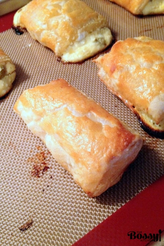 Romanian Farmer Cheese Sweet Pastries are delicious and easy to make. The puff pastry is filled with farmer cheese and raisins and baked to perfection for a lovely dessert or snack.