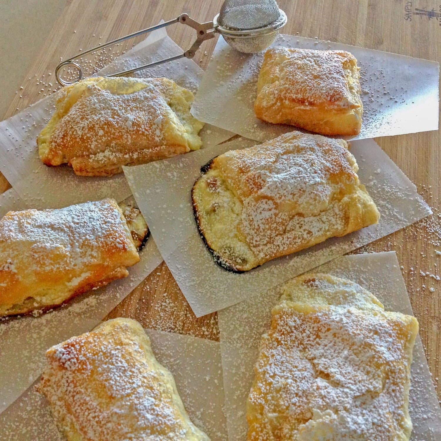Romanian Farmer Cheese Sweet Pastries are delicious and easy to make. The puff pastry is filled with farmer cheese and raisins.