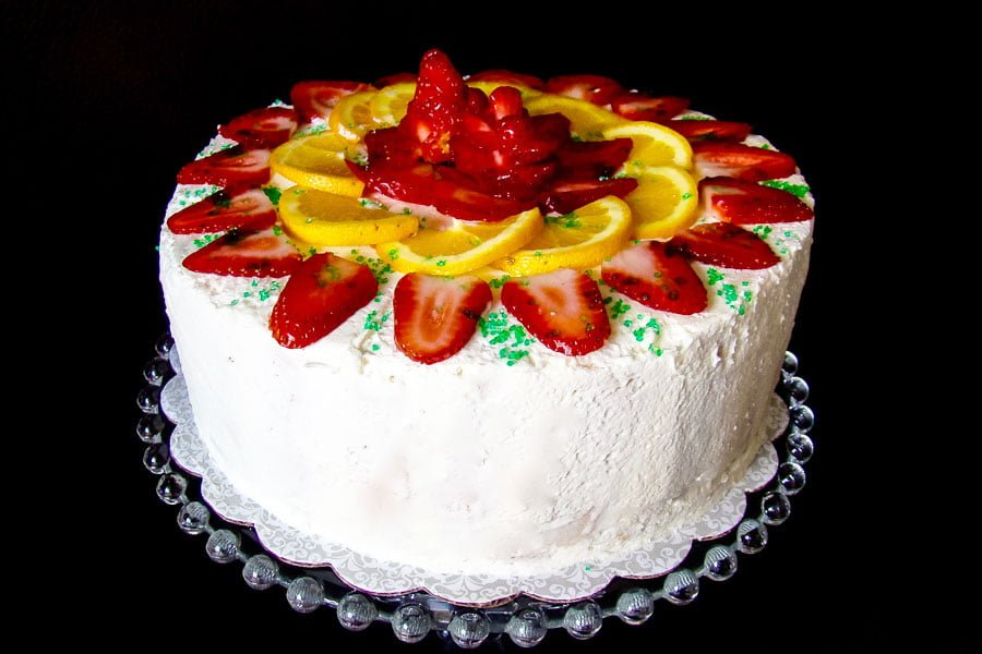 Charlotte Russe Cake decorated with fresh strawberries and oranges