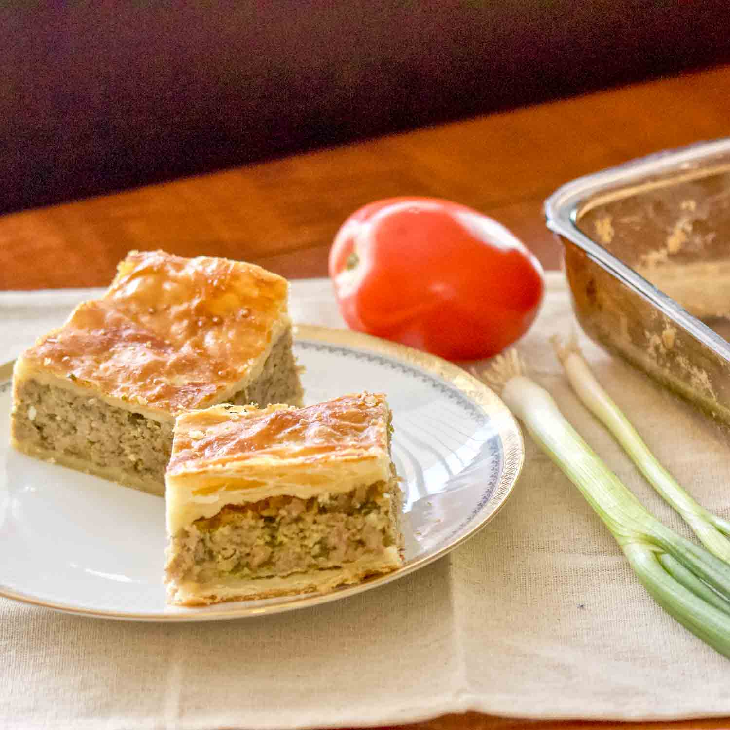 This Romanian Perfect Easter Puff Pastry Minced Meat Pie recipe is a cousin of the Greek Kreatopita pie and a delicious dish I make every Easter. The pie is made with puff pastry and a filling of ground meat that can be pork, beef, or a combination of both. It works great as an appetizer for the Easter meal.
