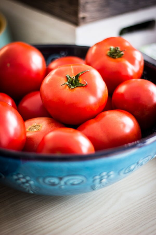 tomatoes in a blue bowl