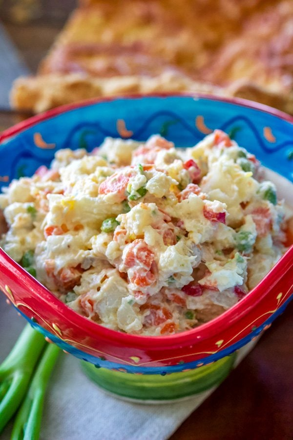 Spanish potato salad (Ensaladilla Rusa) is a Spanish favorite made with potatoes, carrots, boiled eggs, cooked peas, tuna and mayonnaise. Delicious!