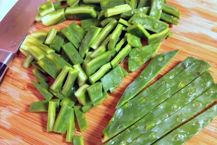 cactus leaves , sliced nopales on a wooden board-