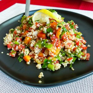 Quinoa Tabblouleh Salad on a black plate44