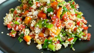 Quinoa Tabblouleh Salad on a black plate44