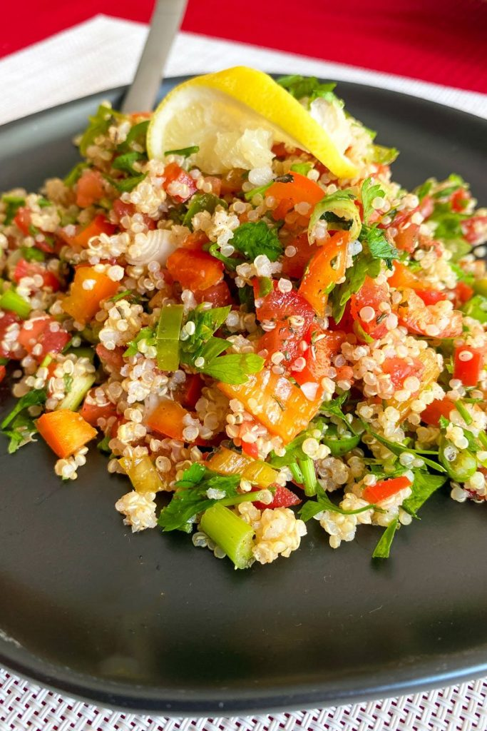 Quinoa Tabblouleh Salad on a black plate