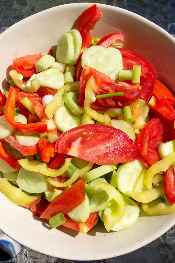 Quick Tomato Cucumber And Pepper Summer Salad is a delicious recipe that uses fresh tomatoes, cucumbers and peppers tossed in vegetable oil and salt.