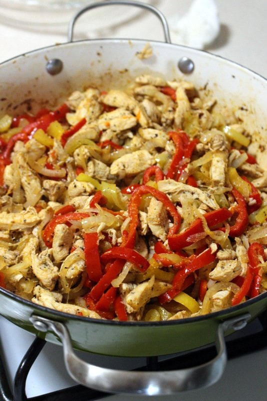 Authentic Mexican Chicken Fajitas-Fajitas De Pollo- cooked fajitas in a green pan