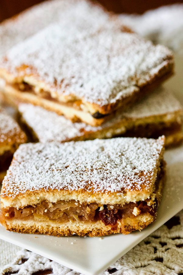 apple pie bars on a white plate