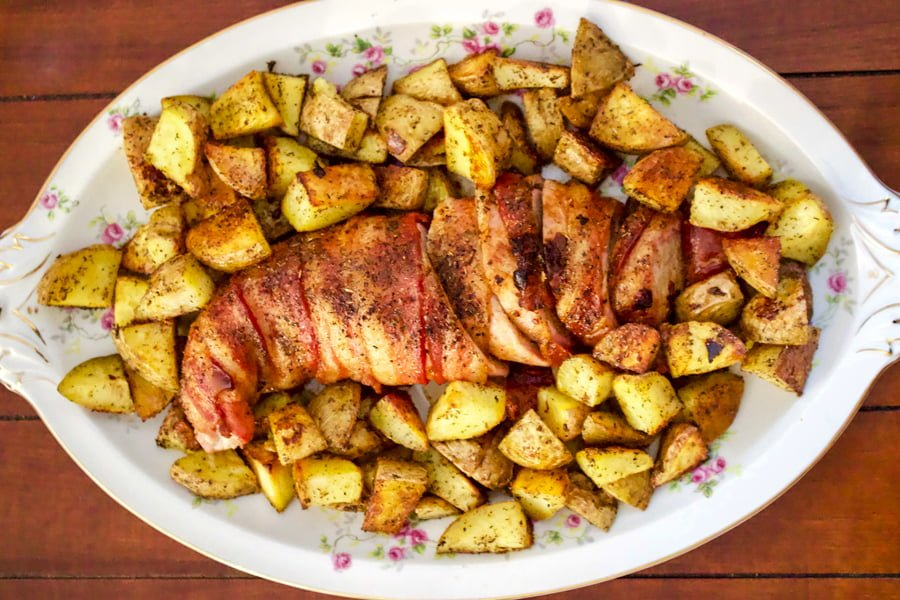 Roasted bacon Wrapped Pork Tenderloin is one of the best recipes for entertaining. Great served with mashed potatoes and salads.