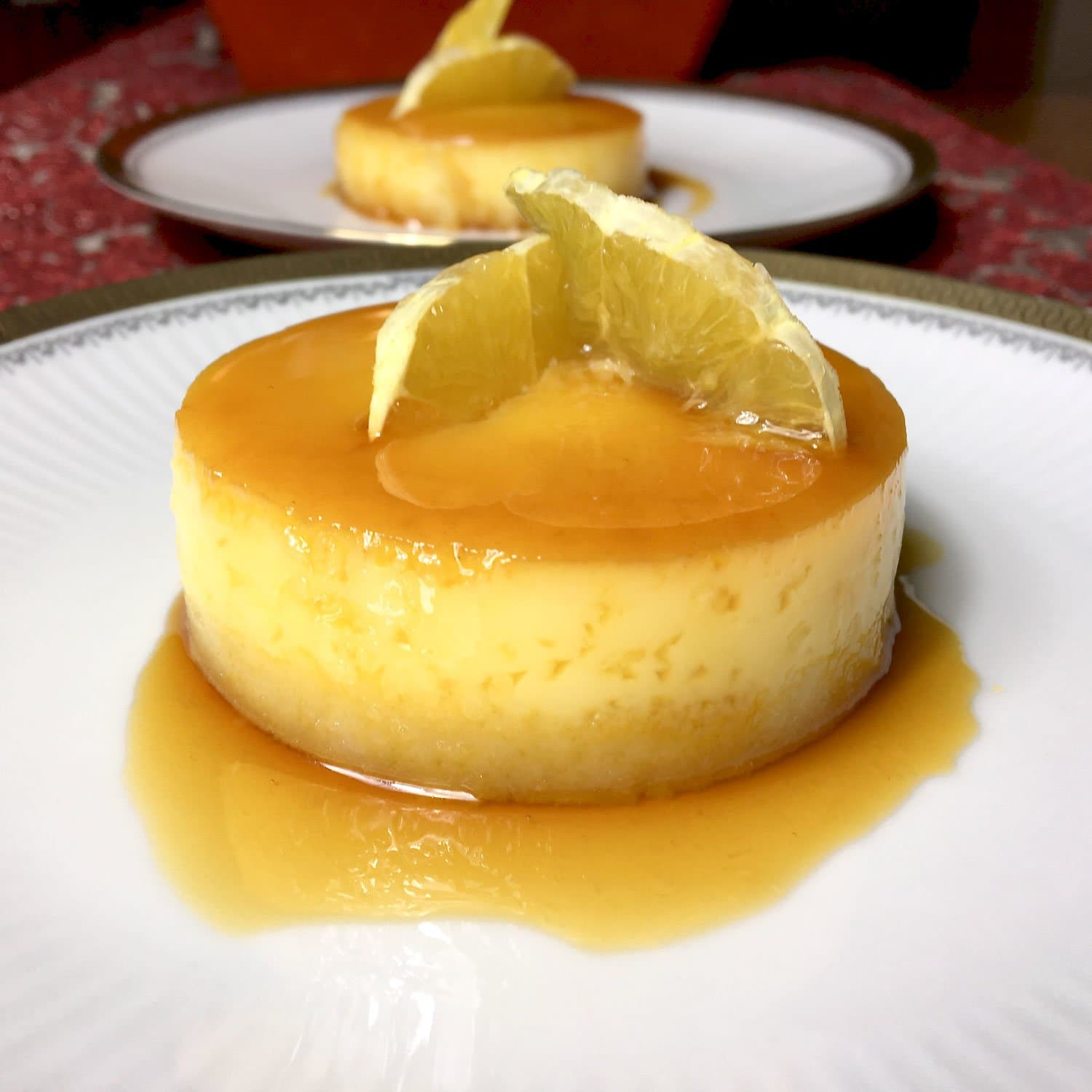 Orange-Almond Flan- Spanish dessert on a white plate