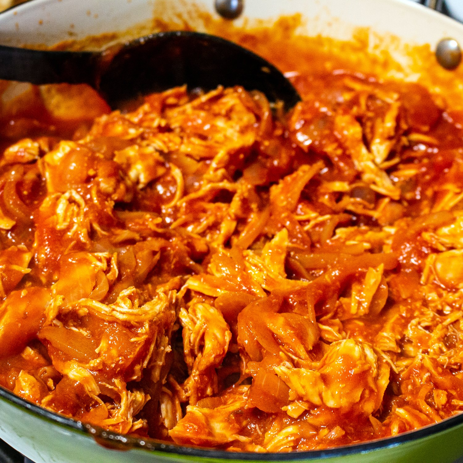 This is an authentic Mexican Tinga de Pollo- Chicken in Chipotle Tomato Sauce, a dish made with shredded chicken in a delicious Chipotle tomato sauce.