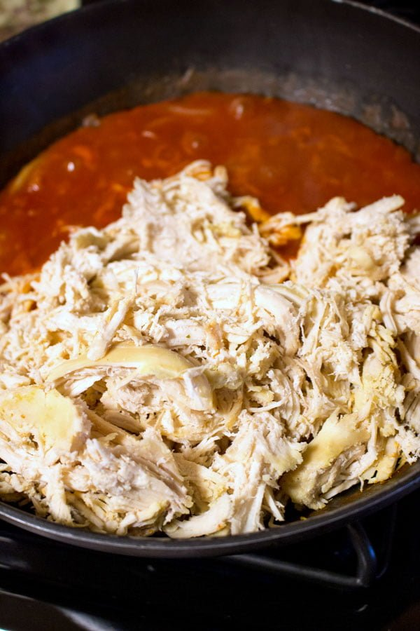 shredded chicken in the tomato salsa in the pan